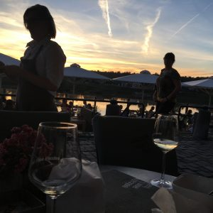 Spectacular sunset and a glass of wine, Eijsden at river Meuse