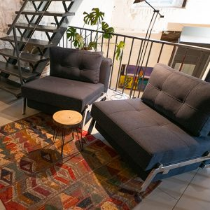 AnnaMarie mezzanine in large living. These design chairs can be comfortable large beds as well